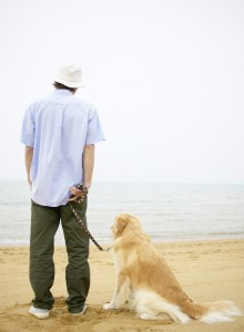 A guy and his Golden Retriever on the beach
