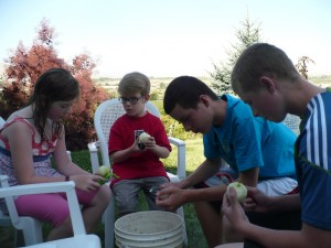 Kids peeling apples
