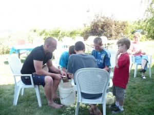 kids peeling apples