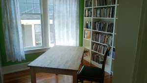 Room with a desk and bookshelves